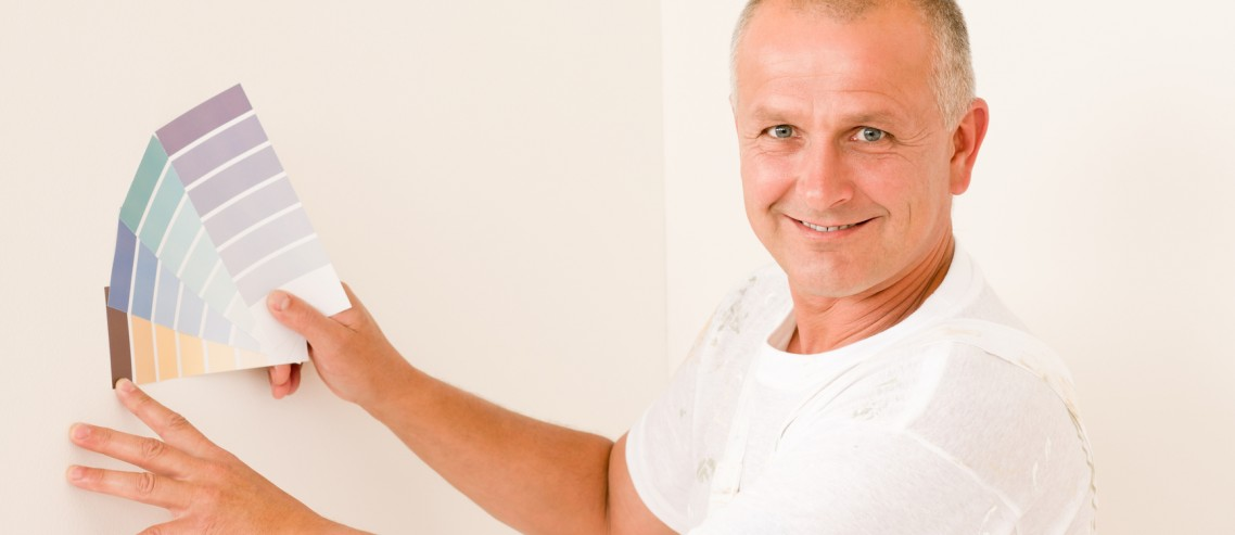 Home decorating mature male painter color swatches
