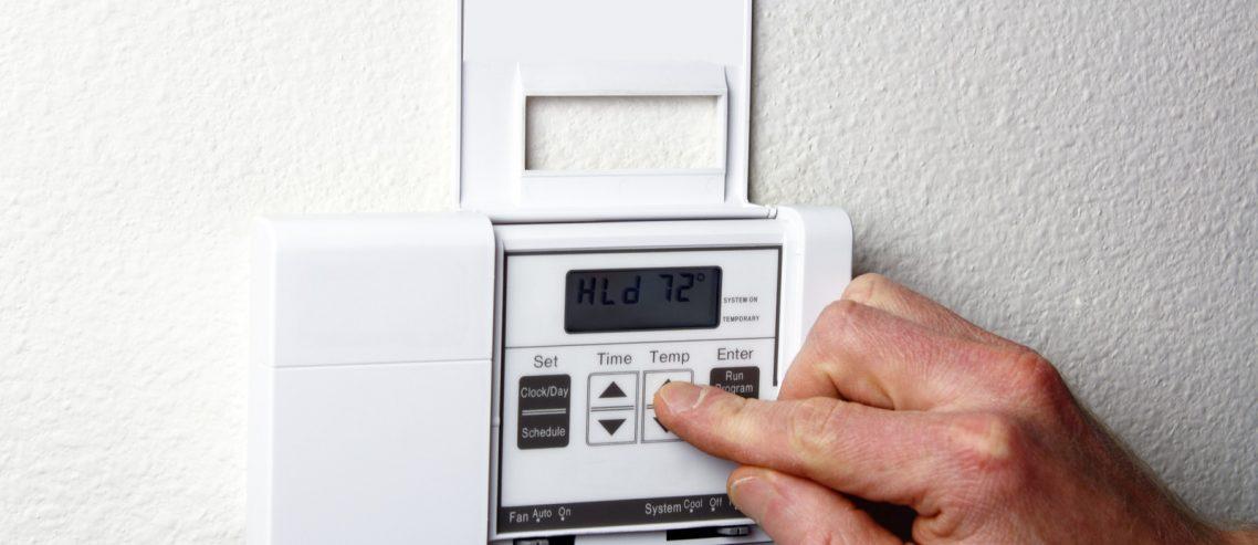 adjusting thermostat - Jason Hull HVAC