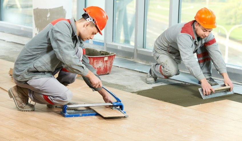 two tilers installing floor