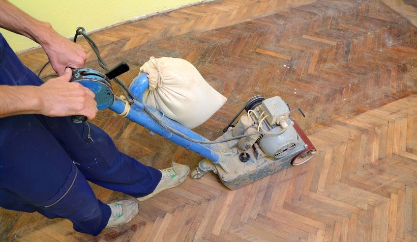 worker polishing old parquet floor
